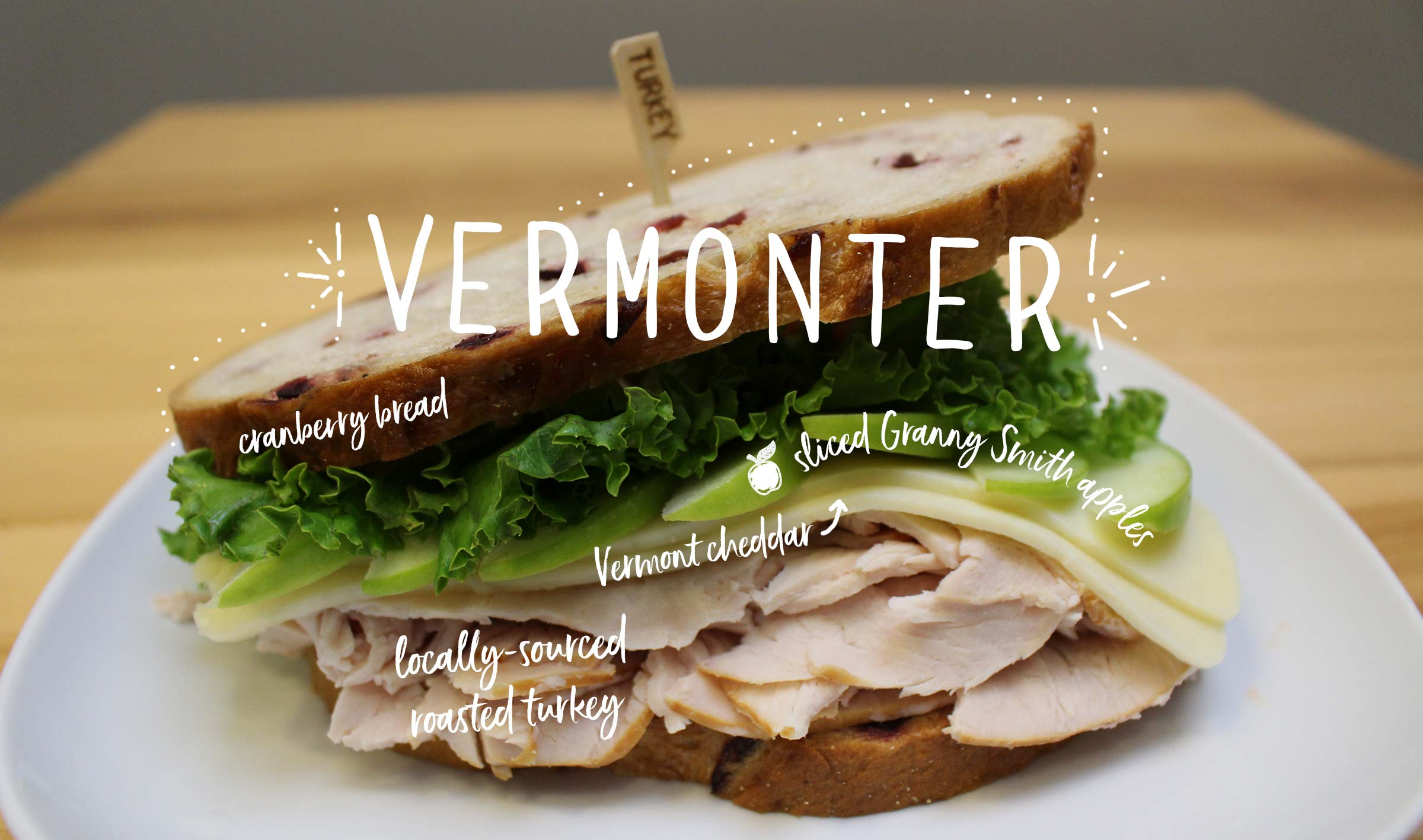 vermonter sandwich: sliced turkey, cheddar, and green apples on cranberry bread